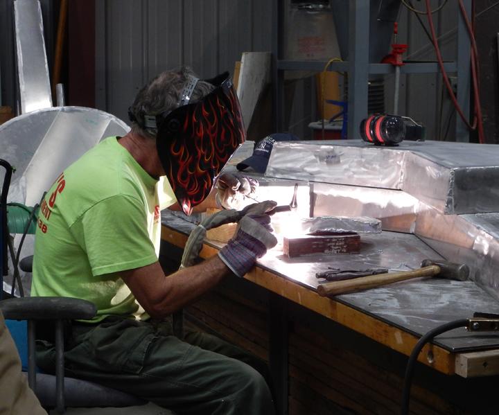 welding on sculpture at Carolina Bronze Sculpture